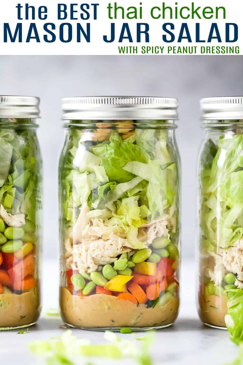 pinterest image for the best thai chicken mason jar salad recipe with peanut dressing