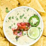 pinterest image of the perfect creamy white queso dip recipe