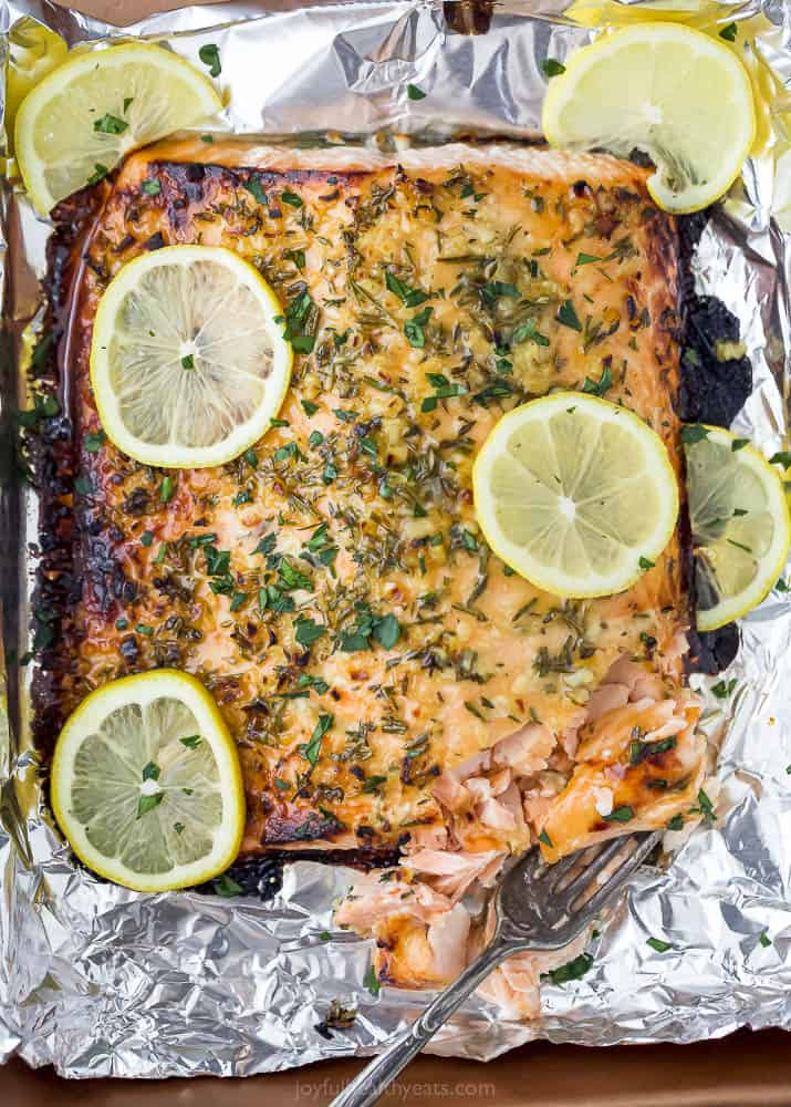 baked honey garlic salmon in foil with a fork