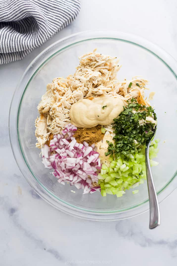 all the ingredients for avocado chicken salad in a bowl