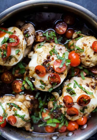 balsamic glazed caprese chicken in a skillet
