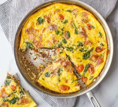 overhead photo of quick and easy prosciutto spinach frittata recipe in a pan