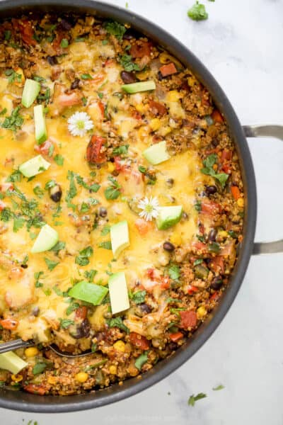 overhead photo of healthy one pan cheesy quinoa taco skillet