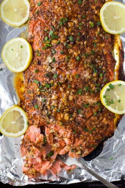 overhead photo of honey mustard baked salmon on a baking sheet