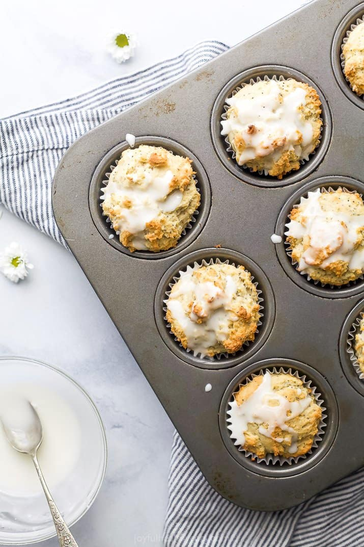 moist gluten free lemon poppyseed muffins in a muffin pan