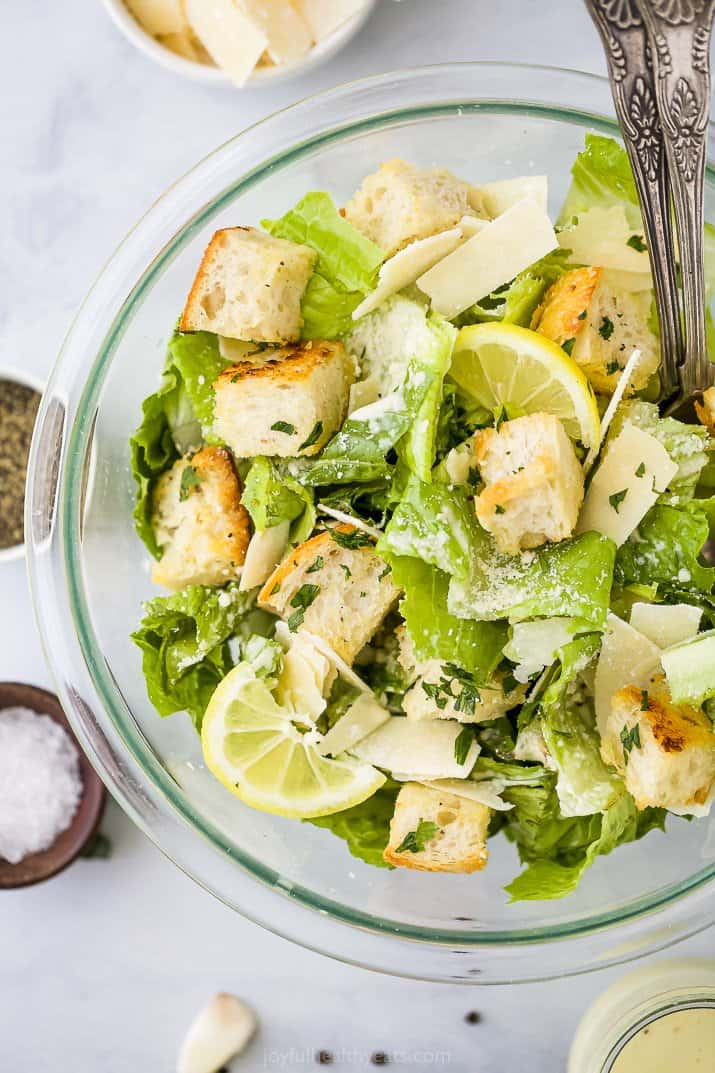 caesar salad with homemade croutons and dressing in a bowl