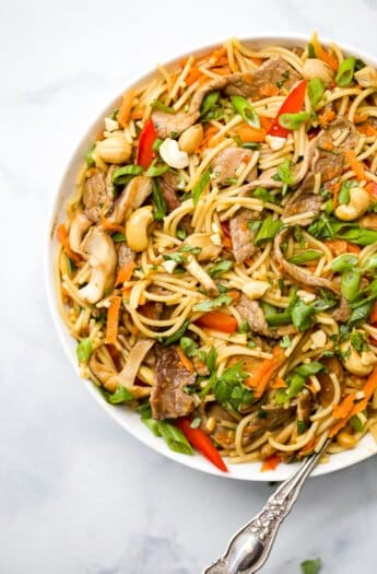 overhead photo of easy kung pao beef noodles in a bowl