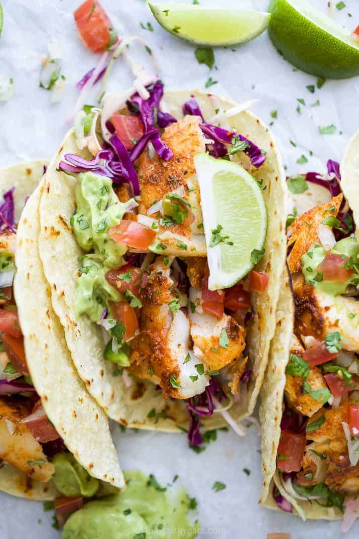 overhead photo of epic baja fish tacos with avocado crema