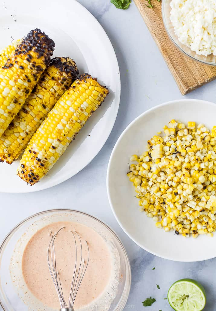 grilled corn and crema in a bowls