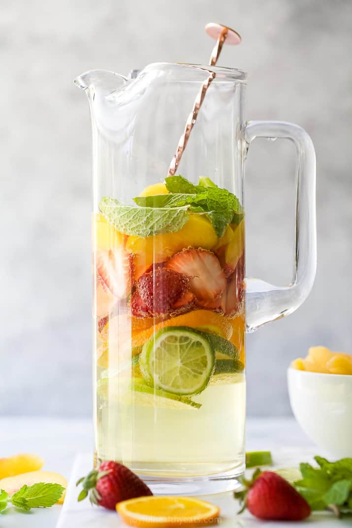 a pitcher filled with strawberry peach moscato sangria