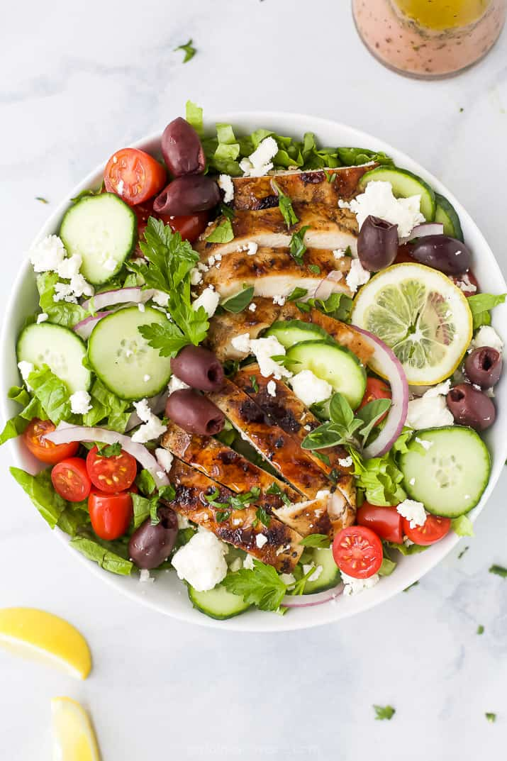 light greek salad with grilled chicken in a bowl
