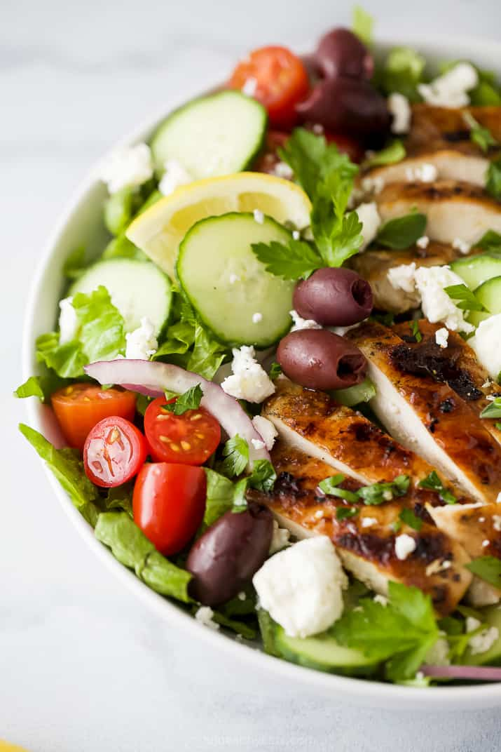 side photo of light greek salad with grilled chicken and greek salad