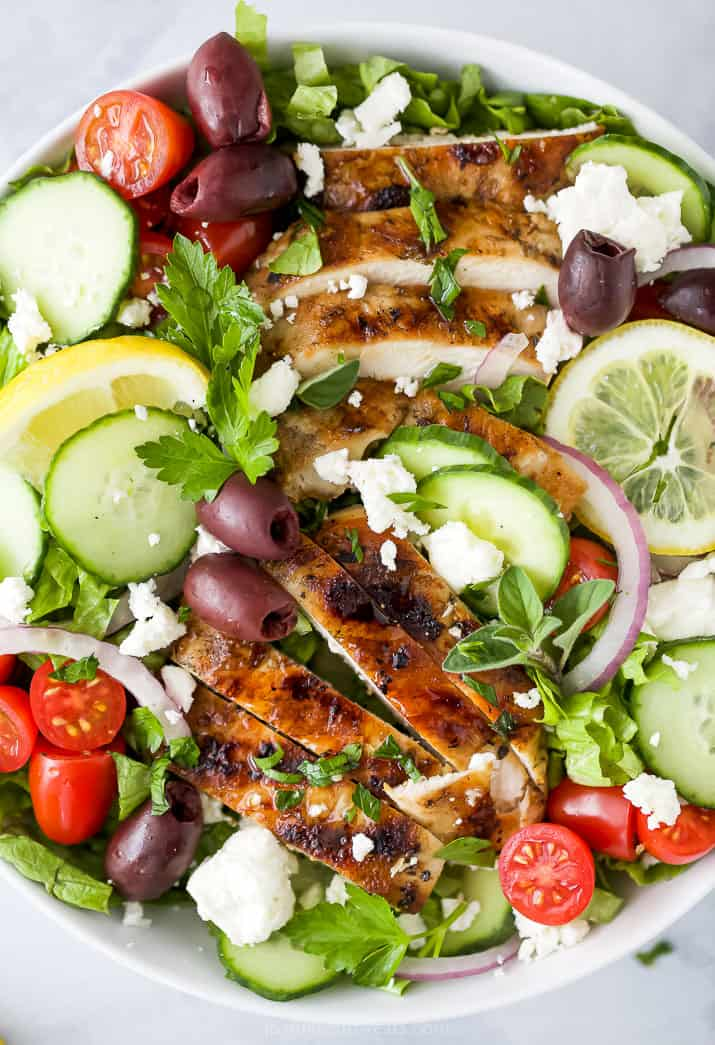 close up of greek salad with grilled chicken