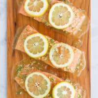 honey garlic cedar plank salmon topped with lemon slices
