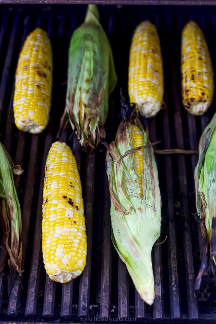 corn on the cob with and without husks on the grill