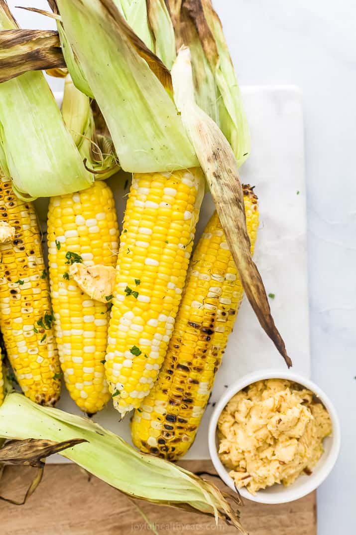 Close up of finished grilled corn on the cob with honey chipotle butter