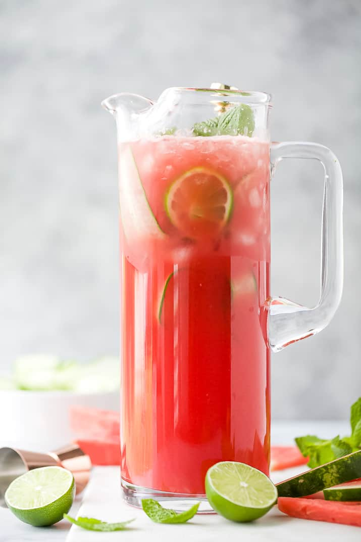 a pitcher filled with refreshing watermelon cucumber gin cocktail