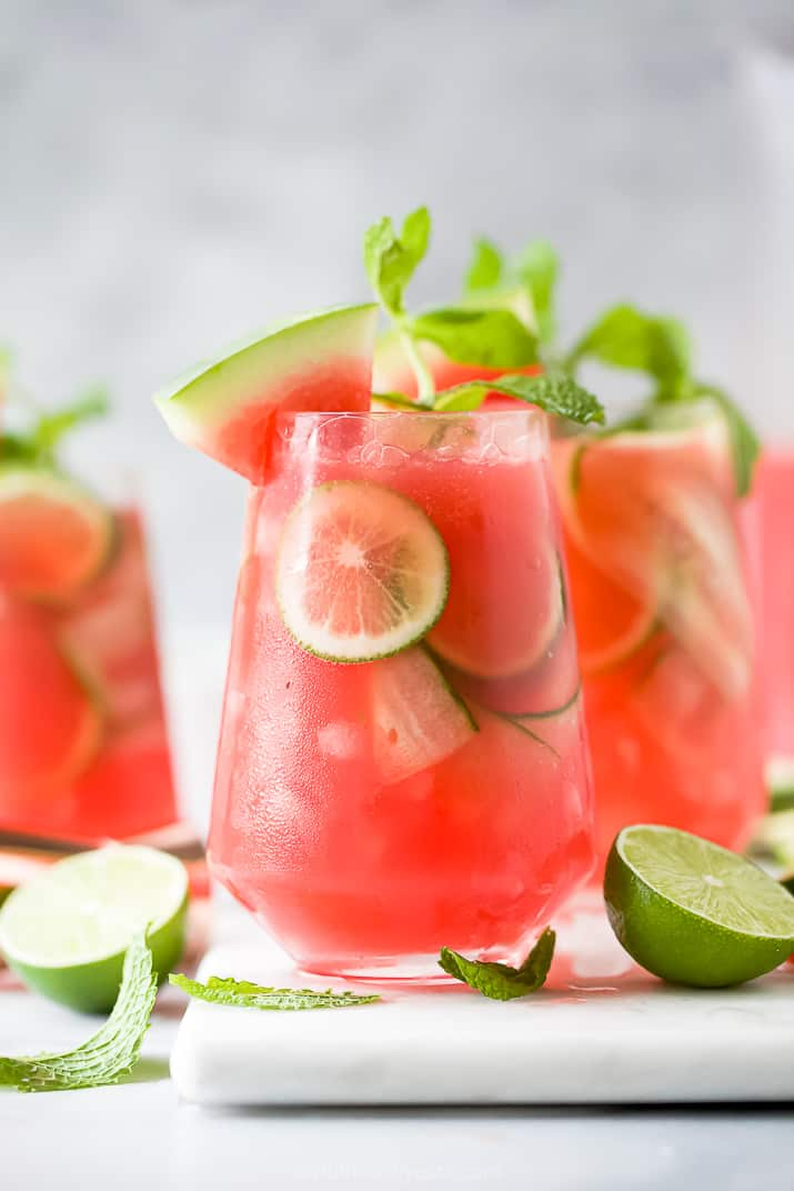 a glass filled with refreshing watermelon cucumber gin cocktail garnished with watermelon
