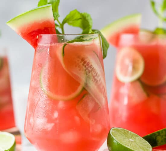 a glass filled with watermelon cucumber gin cocktail