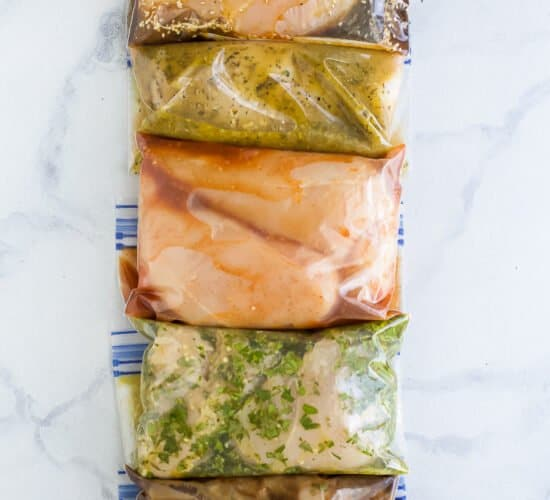 overhead photo of 5 chicken marinades for grilling in ziplock bags