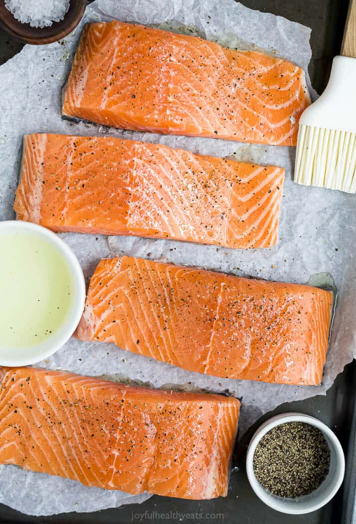 seasoned salmon fillets ready to be grilled