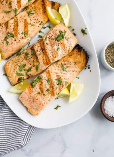 perfectly grilled salmon on a plate with lemon