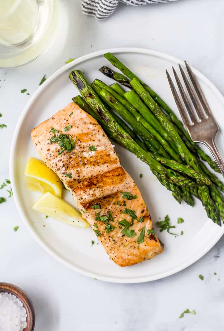 grilled salmon on a plate with grilled asparagus