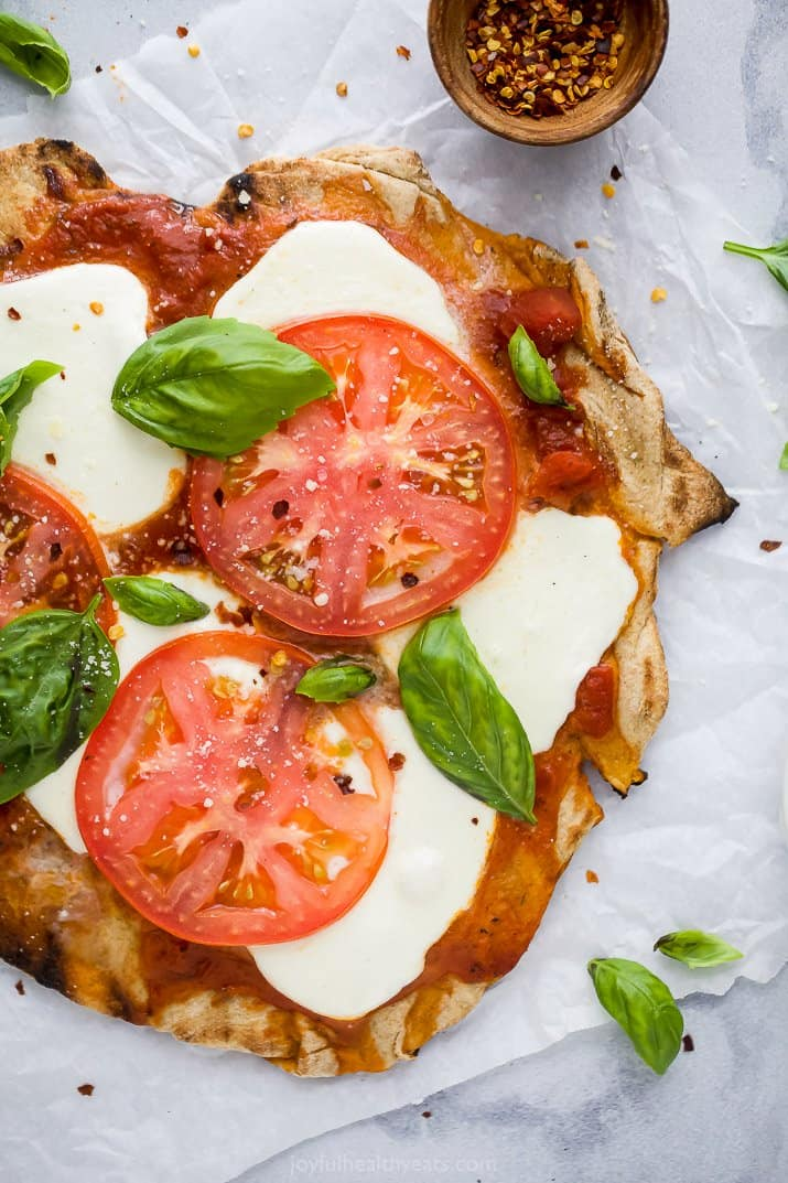 overhead photo of the best grilled pizza recipe topped with margherita toppings