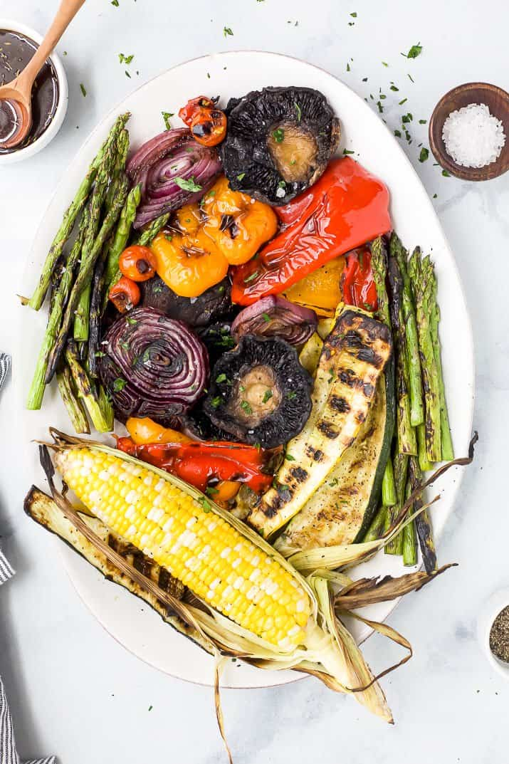 a platter filled with the best grilled vegetables and a balsamic dressing