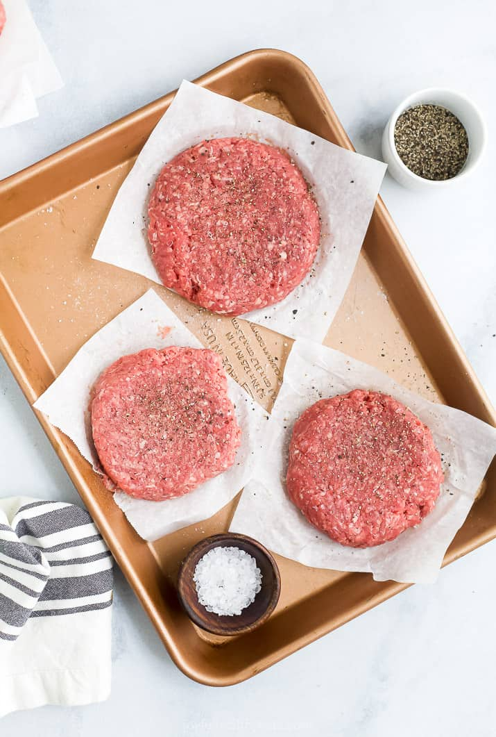 formed burger patties on a baking sheet