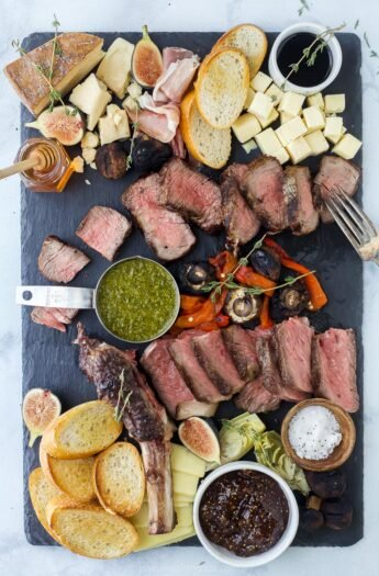 overhead photo of a steak charcuterie board