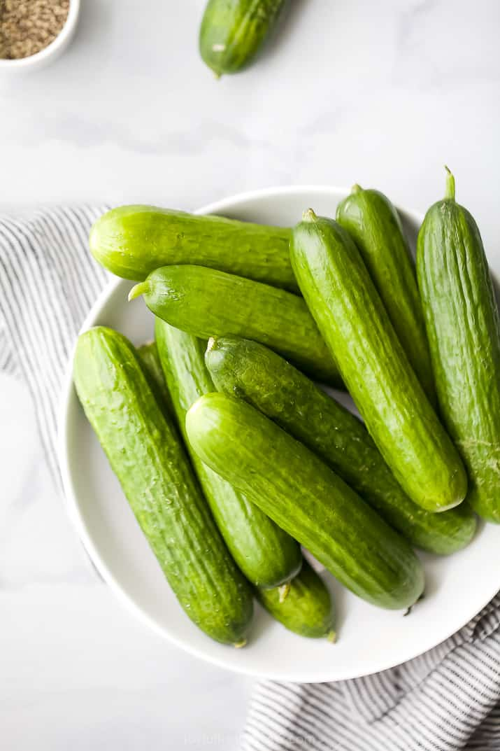 raw pickling cucumbers in a bowl