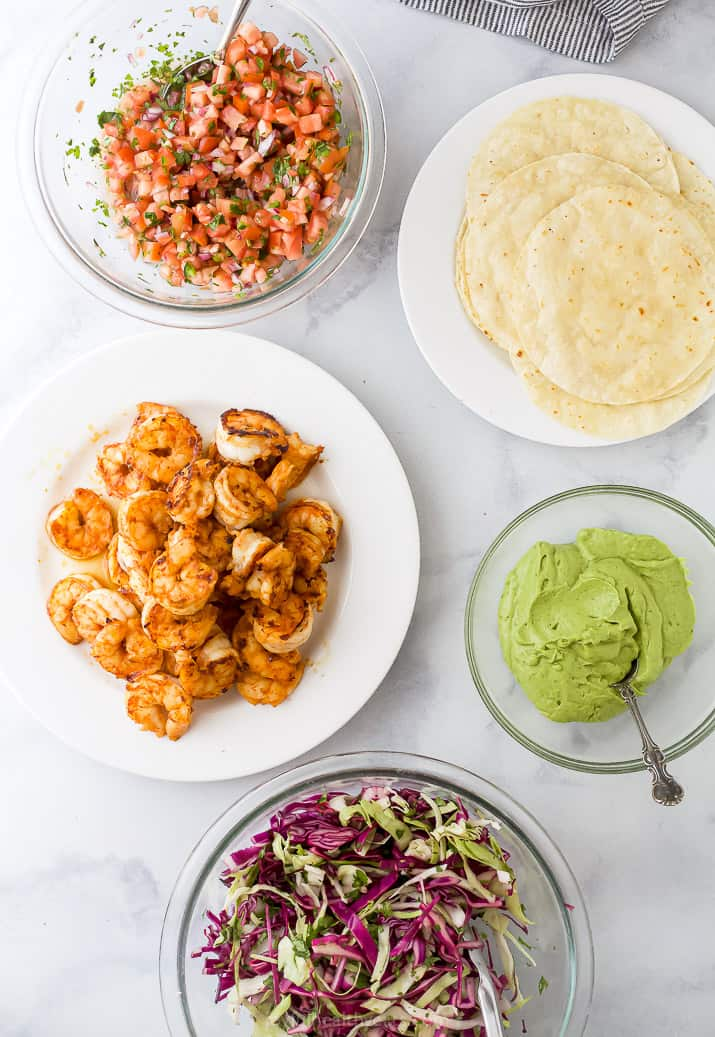 all the ingredients to make spicy shrimp tacos