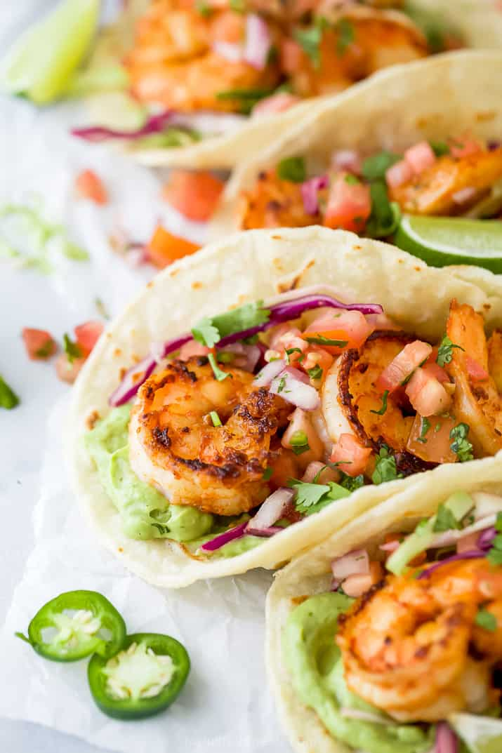 tacos filled with shrimp and cabbage slaw