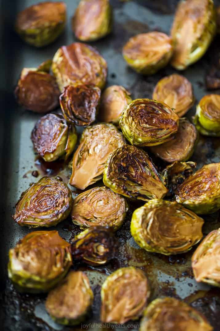 a baking sheet filled with balsamic roasted brussel sprouts