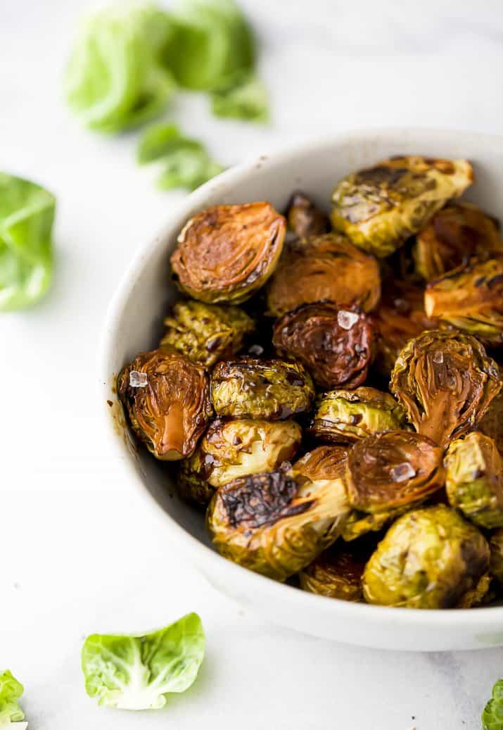 a bowl filled with roasted brussel sprouts