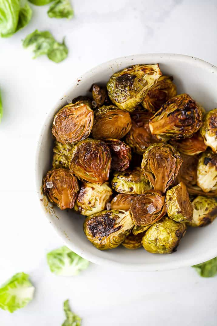 a bowl filled with roasted balsamic brussel sprouts