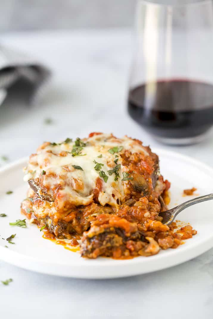 eggplant parmesan on a plate with a fork