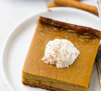 close up of pumpkin pie bars on a plate