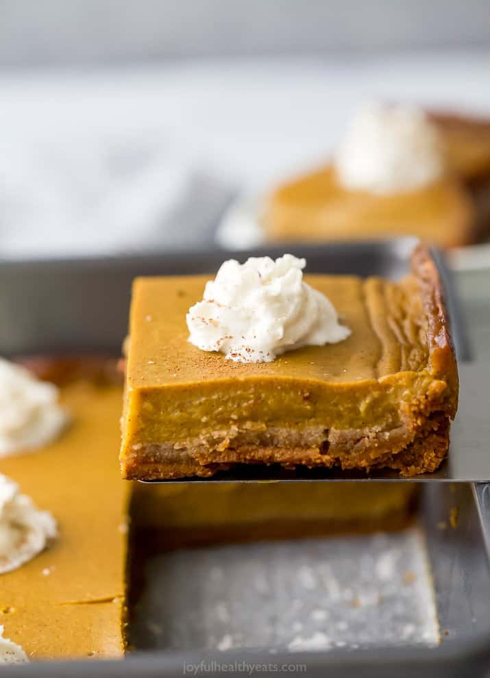 a spatula lifting up a pumpkin pie bar