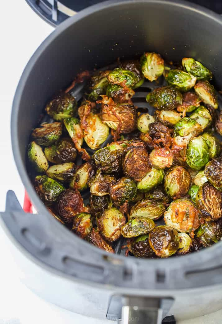 an air fryer with brussel sprouts