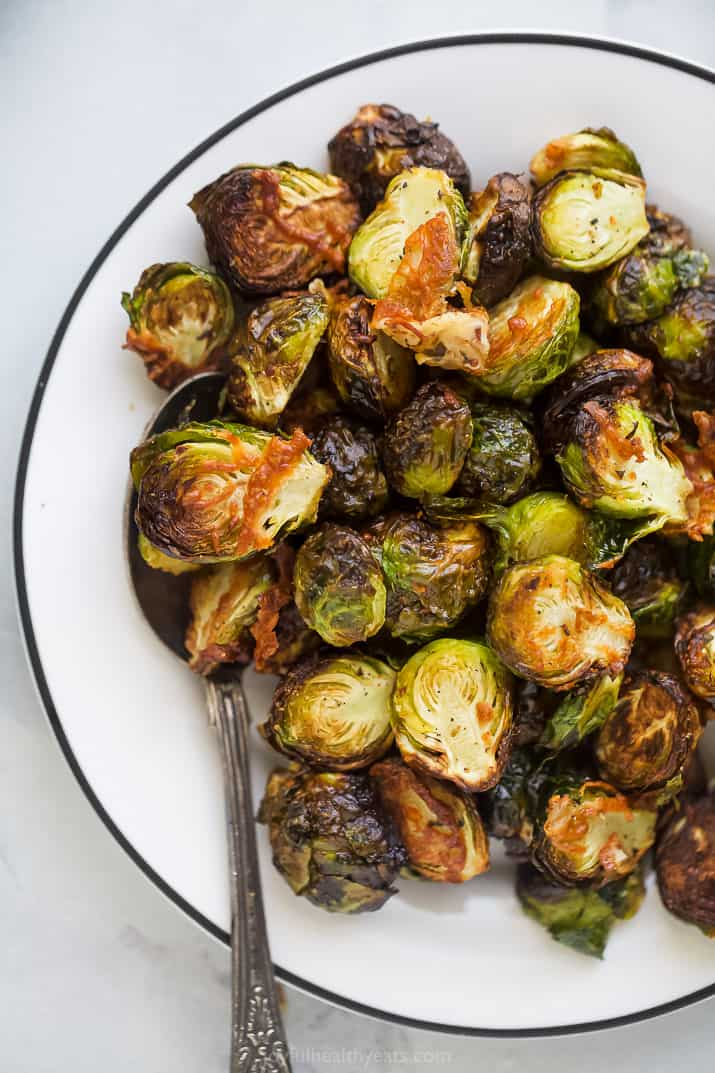 crispy brussel sprouts on a plate with a spoon