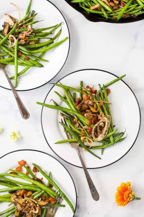 green bean with bacon and onions on plates