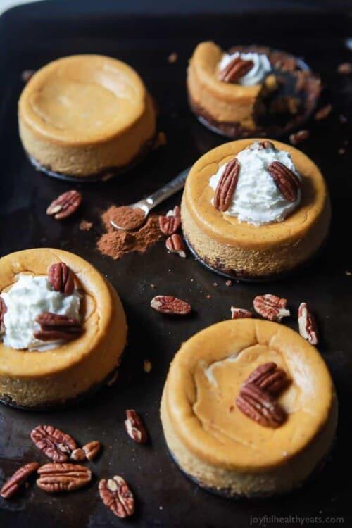 mini pumpkin cheesecakes on a baking sheet