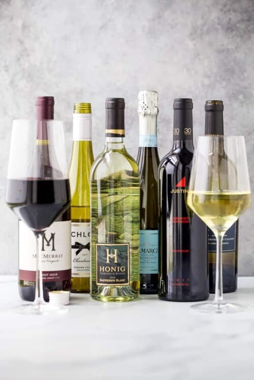 wine bottles with wine glasses