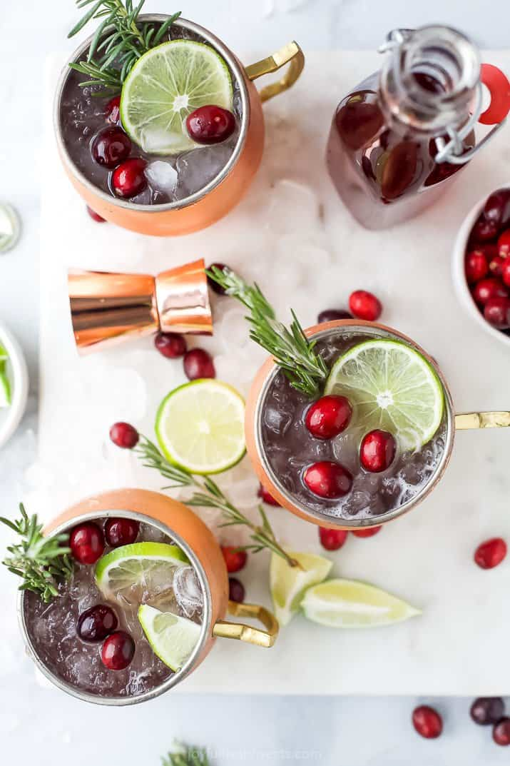 copper cups filled with cranberry moscow mule