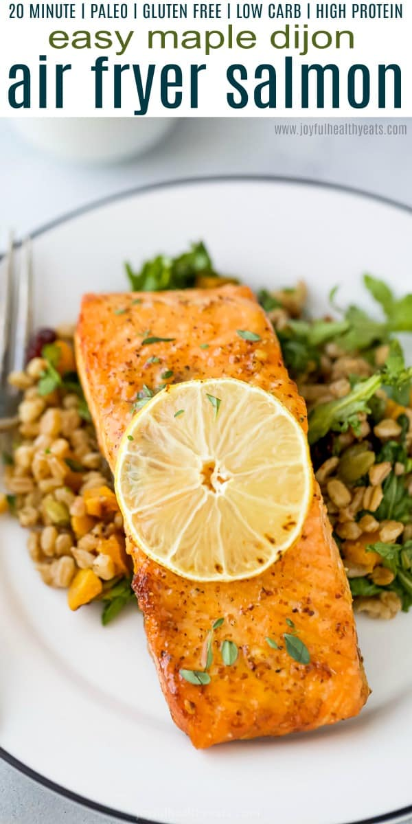 A Bowl Filled with Farro Salad and a Juicy Salmon Filet on Top