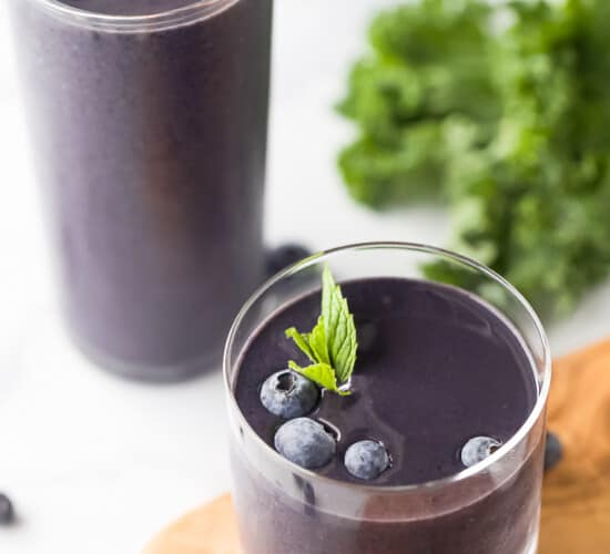 A Tall and a Short Glass Containing Blueberry Kale Smoothies