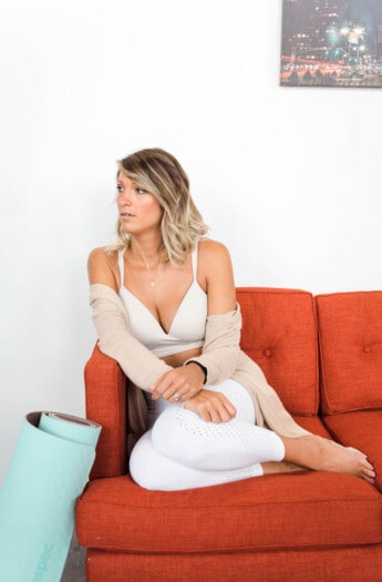 girl on a couch with workout clothes