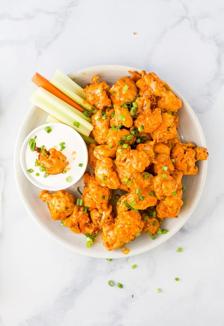 A Bowl Filled with Buffalo Cauliflower Bites, Ranch and Raw Veggies